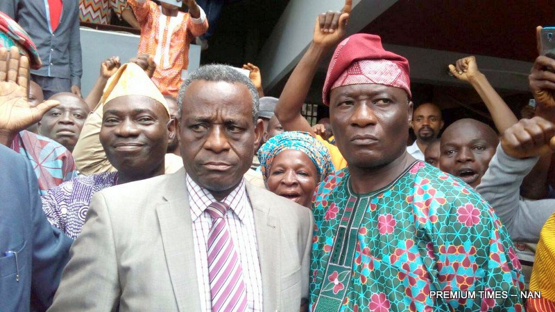FILE PHOTO: Acting Vice-Chancellor, Obafemi Awolowo University (OAU), Prof. Anthony Elujoba (L) and Public Relations Officer of the Institution, Mr Abiodun Olarewaju, with some supporters rejoicing over the election of Prof. Elujoba as the Acting Vice-Chancellor in Ile-Ife, Osun, on Thursday (21/7/16) 5236/21/7/2016/EDA/HB/BJO/NAN